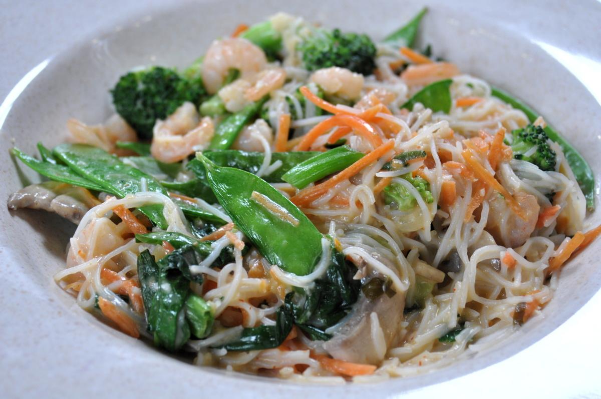 Stir fry curry with snow peas, broccoli, carrots, shrimp, rice noodles ...