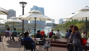 Songdo residents take in the views along the water.