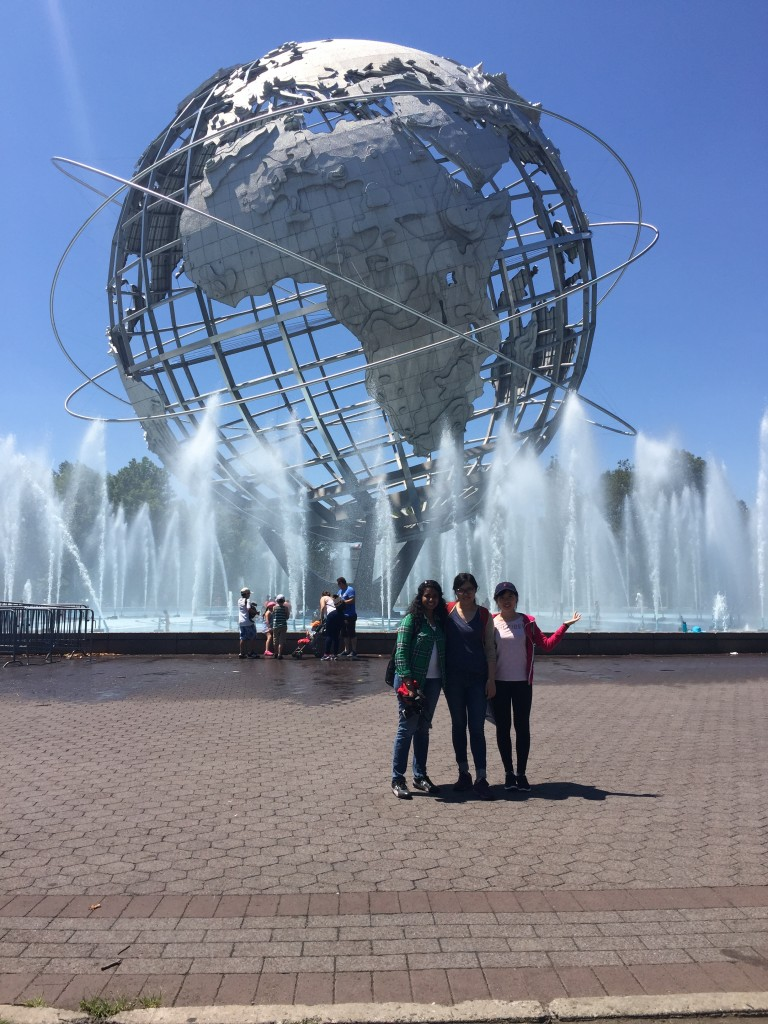 Geslin George, Xiao Shi, and Yanlei Feng on a data collection visit to Flushing Meadows Corona Park. They pose in front of the massive Unisphere fountain, a centerpiece in the historic core of the park.