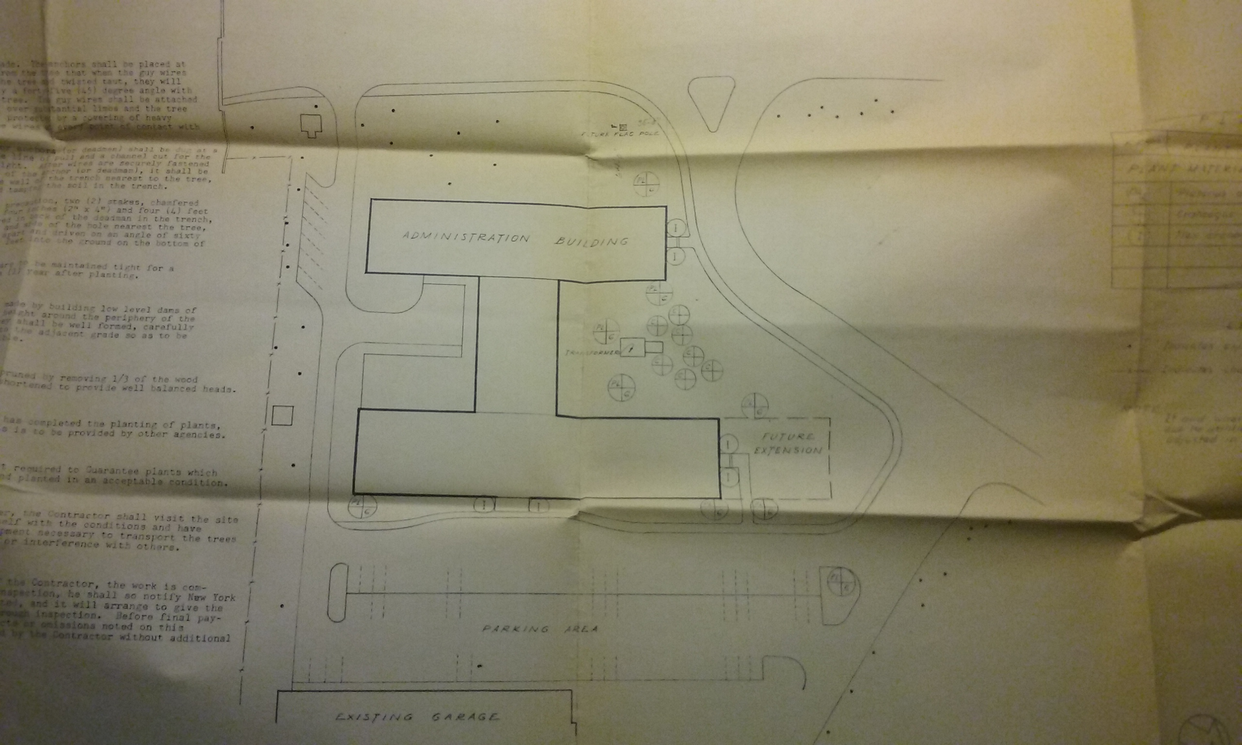 Photo of a site plan for the administration building, which also contained information about plantings.