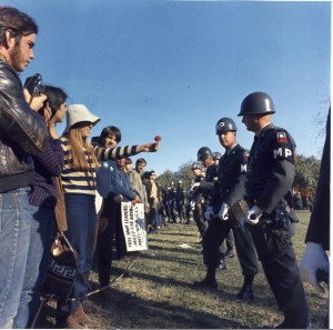 A young woman offers a flower to military police officer at an October 21, 1967 march to the Pentagon. [National Archives]