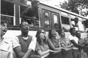 "Interracial group of Freedom Summer volunteers singing ""We Shall Overcome,"" the anthem of the Civil Rights Movement, on June 19, 1964."