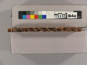 We can see the remnants of the spine of the earlier binding under the new oversewing added by the commercial binder.