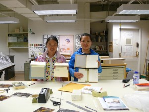 Zhimei (left) and Chunmei are holding their book models.