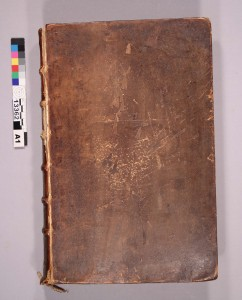 The front board of Shakespeare's Fourth folio, before treatment. The tailband is hanging off.
