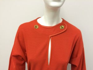 Detail of jersey wool dress and neckline closures.