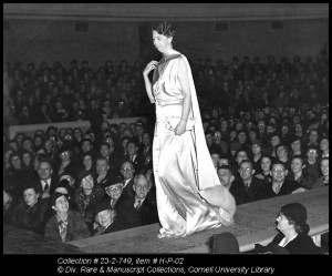 Eleanor Roosevelt walks down the runway in her inaugural ball gown during Farm & Home Week in 1937. She later donated the dress to the Cornell Costume and Textile Collection (#915).
