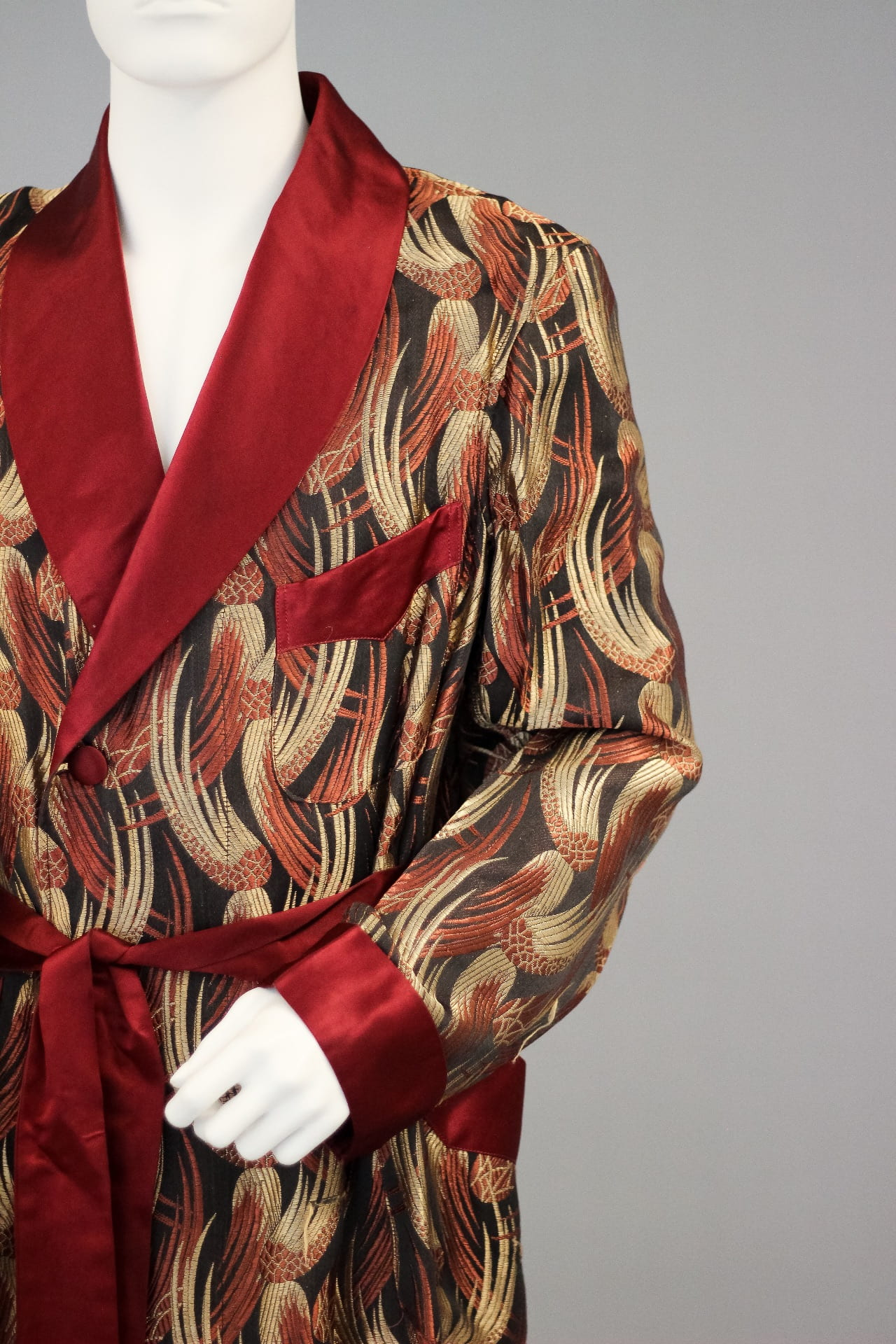 Man's house robe from the 1940s, which features a brocade wing design. Photo by Grace Anderson.