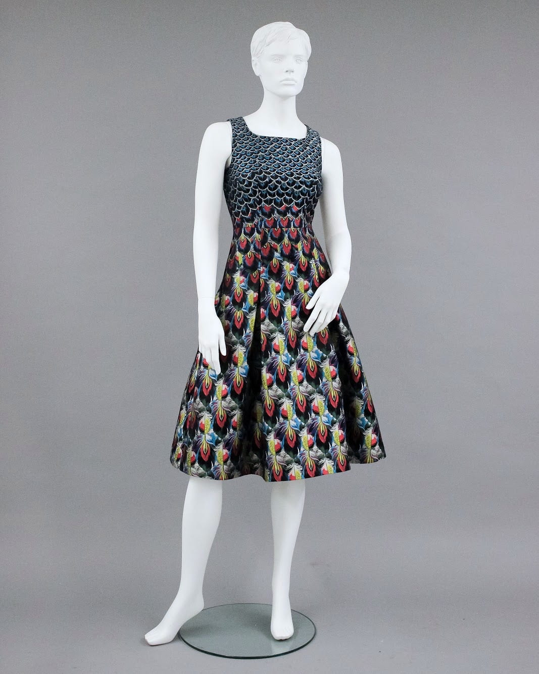 """""""Talon"""" evening dress with jacquard design of peacock feathers. Designed by Mary Katrantzou for her Resort 2018 collection, and inspired by Baron Rothschild's extensive nineteenth-century taxidermy collection. On loan from the Texas Fashion Collection, University of North Texas (identification: 2018.006.017)"""