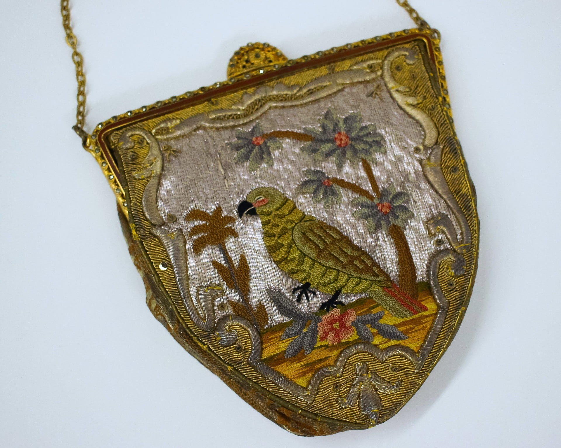 Embroidered evening bag, circa 1920 - 1932, that may depict a parrot in the genus Amazona; however, because the parrot is represented on the ground it may be a Kakapo. Photo by Grace Anderson.