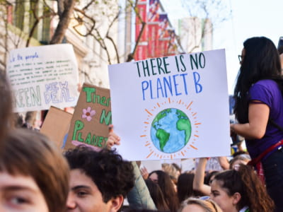 students at climate change rally with sign reading no planet b