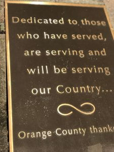 Plaque with the following words: Dedicated to those who have served, are serving and will be servinf our Country - Orange COunty thanks...(words cut off)