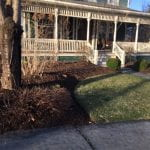 Freshly mulched garden bed in front of a house