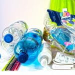 Plastic Waste - a pile of plastic water bottles, straws, pill packs and bags