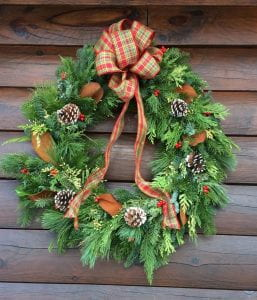 Holiday Wreath with pine cones and a red and green plaid bow