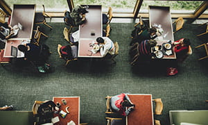 Aerial view of individual eating at the Trillium Dining Hall.