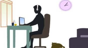 silhouette of person working at desk with cat on floor behind chair.