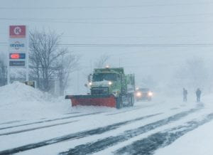 Snow plow in a winter storm