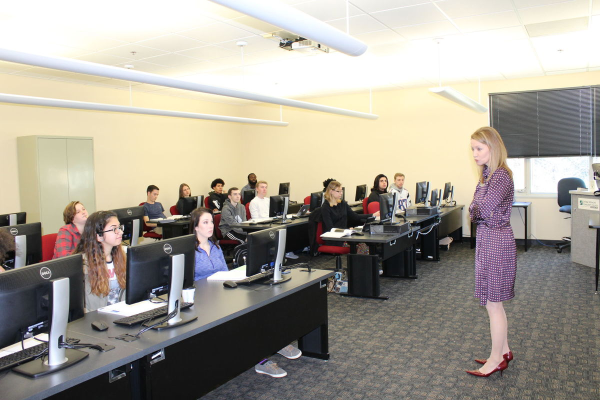 Dr. Deitemeyer talks to CPCC students in a classroom.