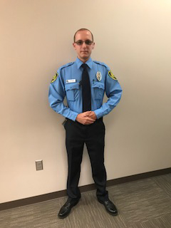 Security Officer In Blue Uniform