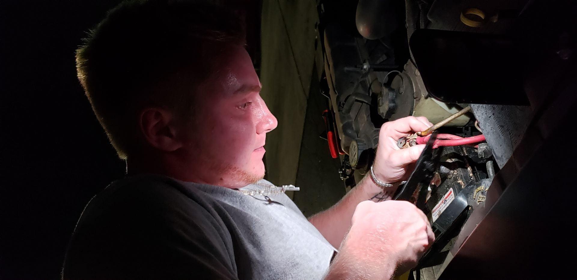 chris fixing battery