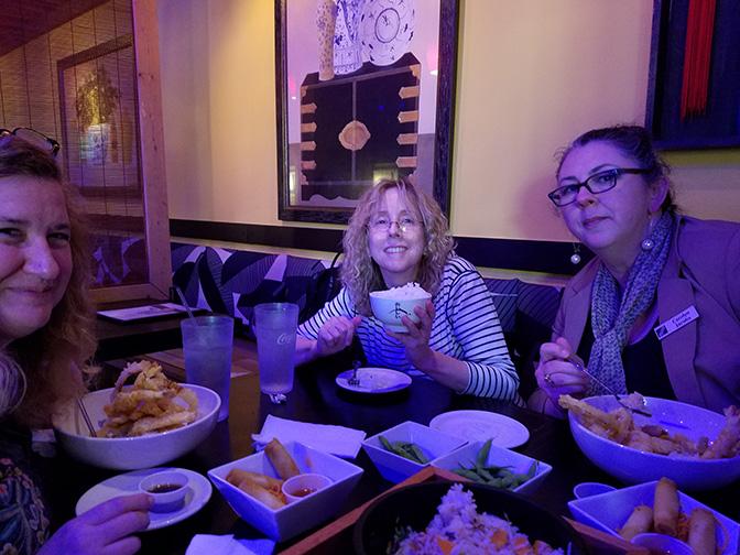 Left to right: Paula Smith, Mary Kilburn and Carolyn Jacobs enjoy dinner.