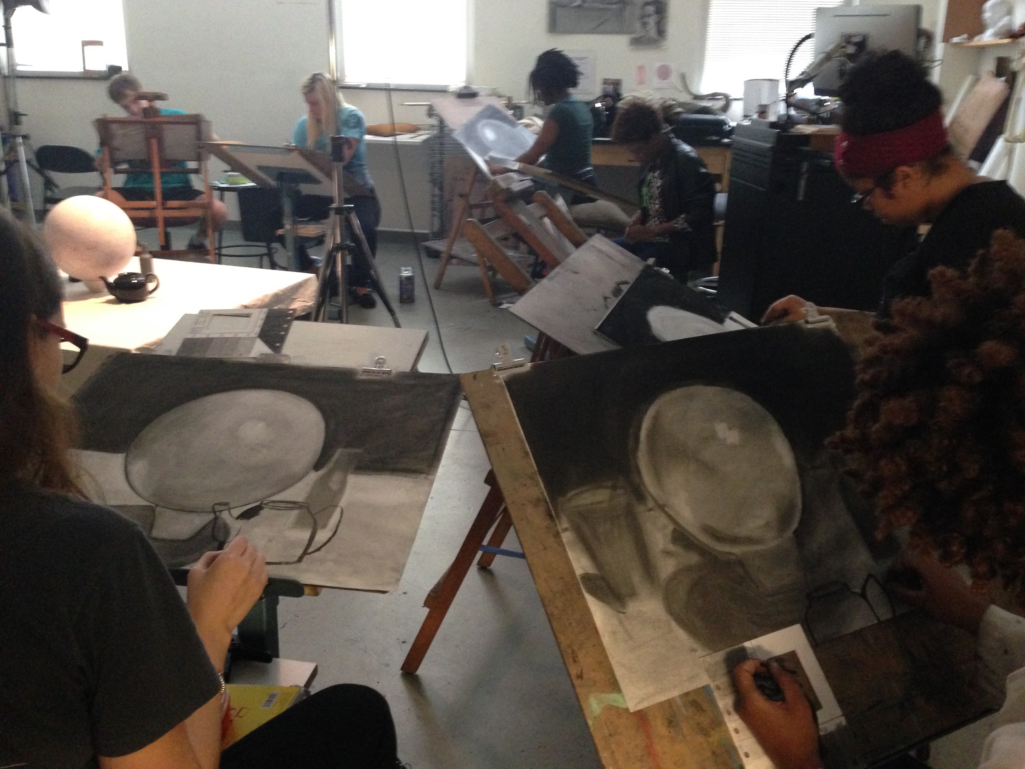 Drawing classroom with students working on a simple value study