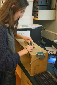 Hannah '15 works on a prototype of the poetry painting robot.