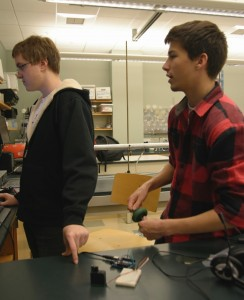 John '15 and Adam '15 work on the motor for the Idea Rolodex.