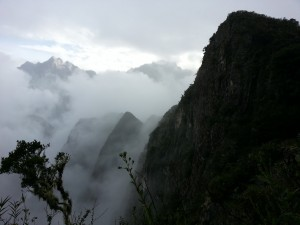Fog around peaks of Andes at Machu Picchu