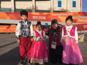 Heather with three korean chlldren dressed in traditional korean outfits