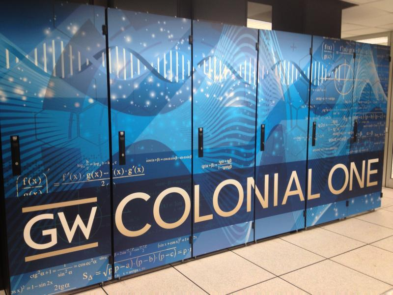 Image of back of server rack doors with the GW Colonial One banner on blue background with math equations