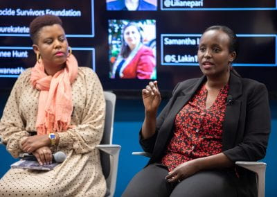 Panelists speaking at How Women Saved Rwanda event