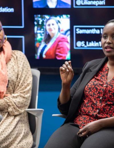 Panelists speaking at How Women Saved Rwanda event
