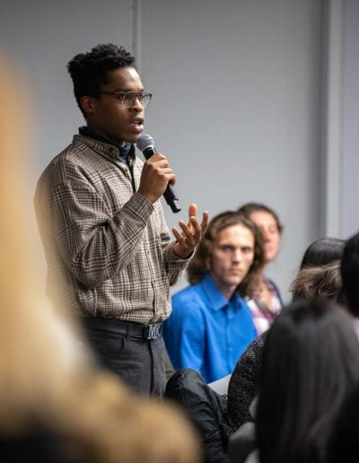 Student asking question at How Women Saved Rwanda event