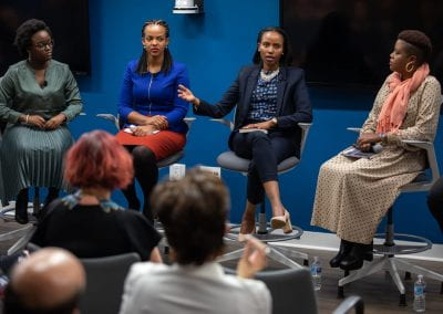 Panelist speaks at How Women Saved Rwanda event