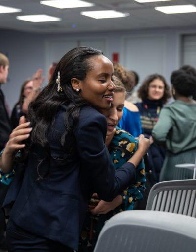 Two women hug at How Women Saved Rwanda event