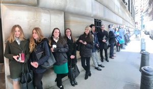 Site Visit Days: New York City; Students stand outside employer building