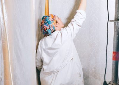 Painter re-painting Casa Batlló
