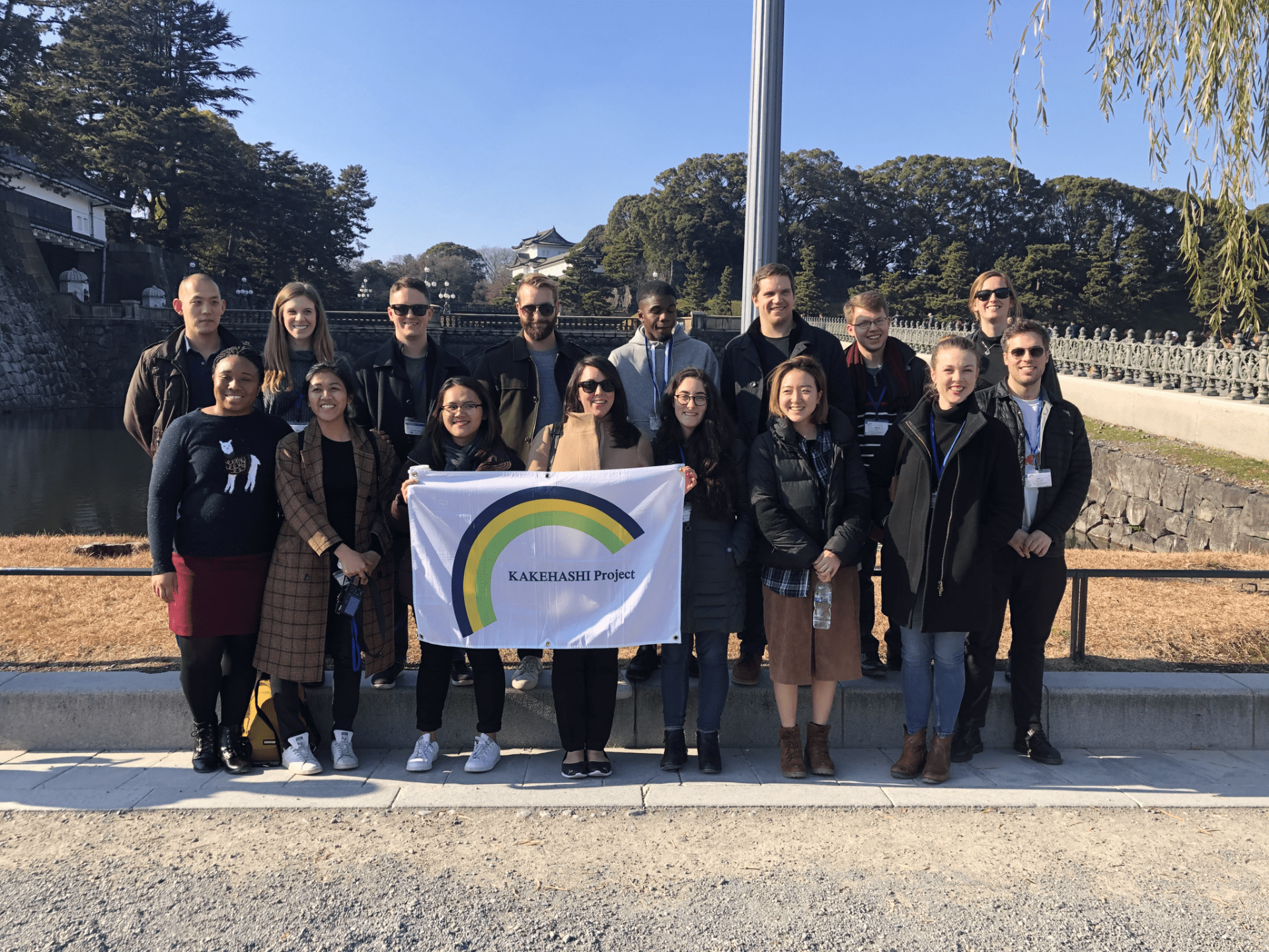 Kakehashi Project student group poses with a Kakehashi Project flag in Japan