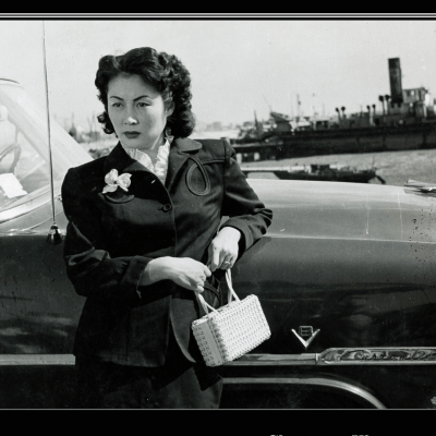 Korean woman in the 1950s leaning against car