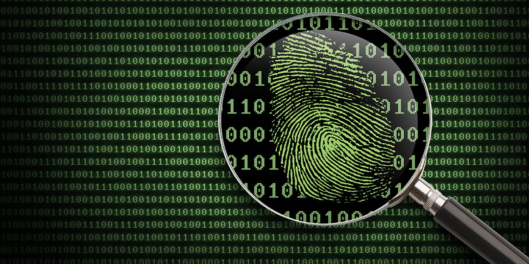 graphic of a magnifying glass over a thumbprint on a binary code background