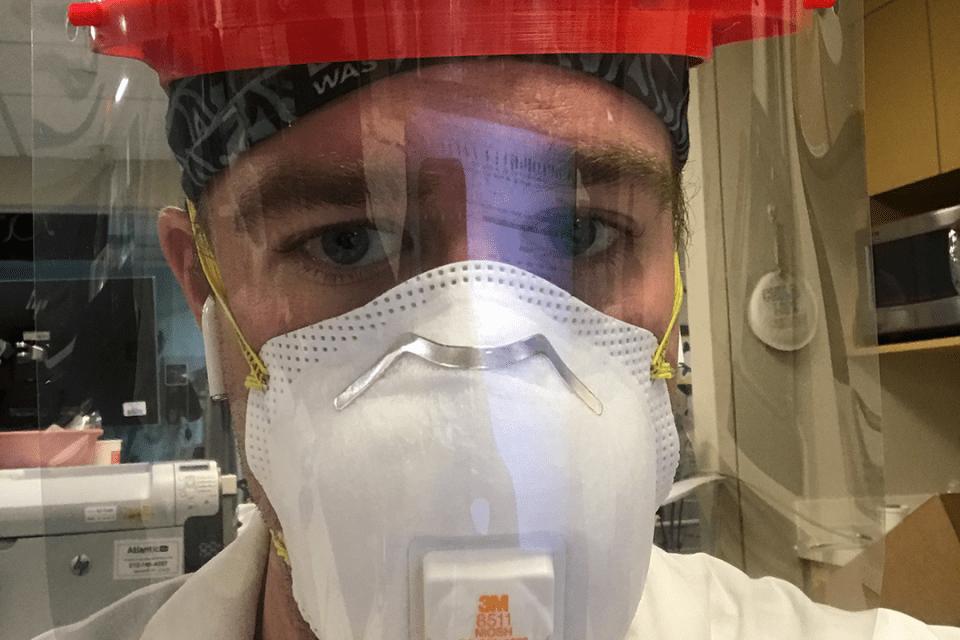 Luke Frey wearing an n95 mask and a face helmet