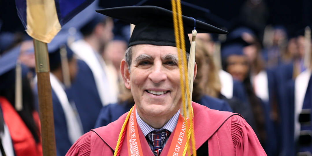 Professor of Chemistry Michael King serving as Columbian College Marshal during a graduation ceremony