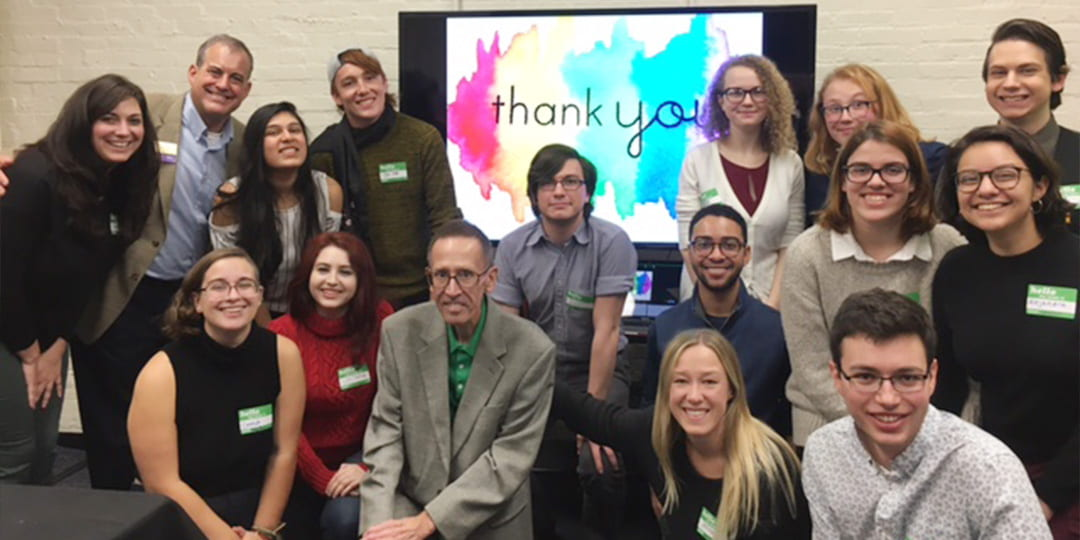 Alumnus Michael Schmidt with students from the LGBTQIA Resource Center