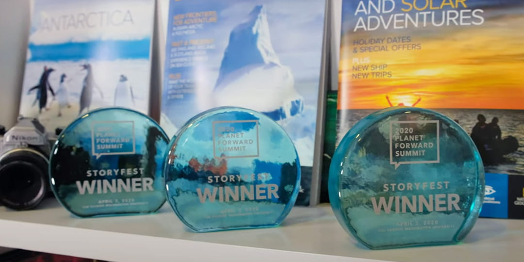 Three 2020 Storyfest trophies on a bookshelf