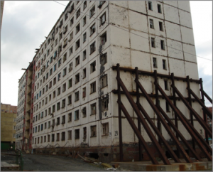 Figure 3: A building is temporarily braced against collapse.