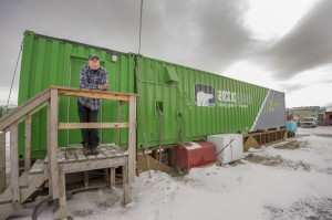 An employee waits outside an indoor vertical farm in Kotzebue, Alaska. The unit provides kale, various lettuces, basil and other greens for the community of nearly 3,300. Source: Will Anderson via AP