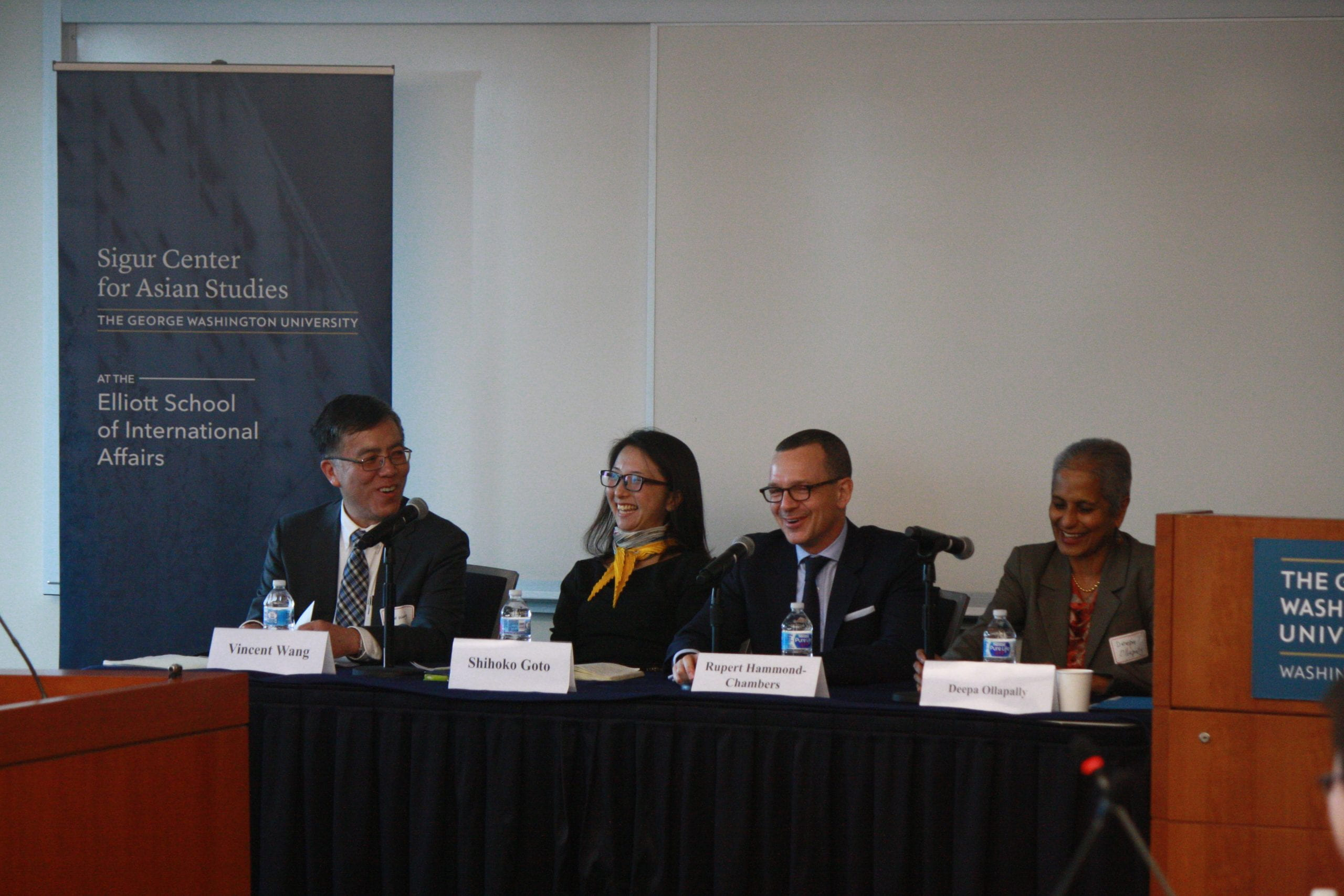 """Expert panelists discussing trade, investment, and services in the """"US-Taiwan Economic Relations: Domestic and International Drivers"""" conference held on December 5, 2017. From left to right: Vincent Wang, Shihoko Goto, Rupert Hammond-Chambers, and Deepa Ollapally."""