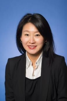 Professor Jisoo Kim, pictured in professional attire